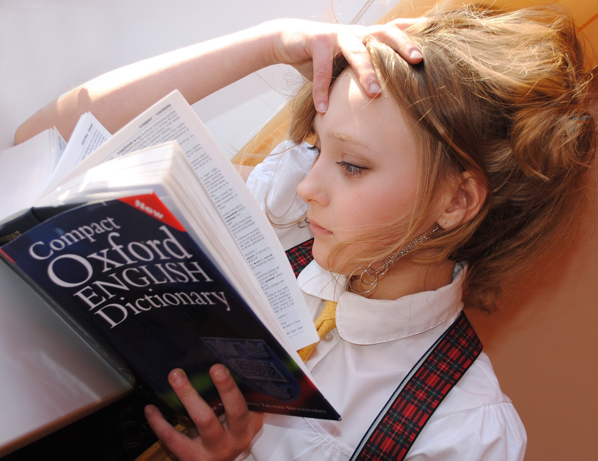 Girl with dictionary.